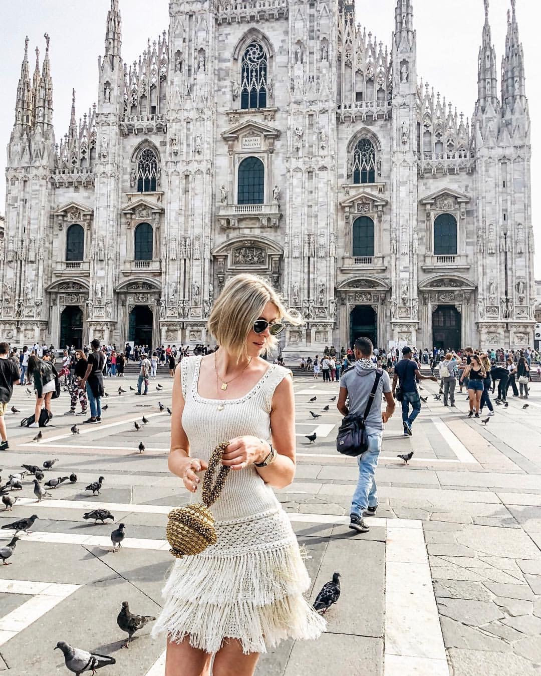 Fashionista's resident columist's Sofie Valkiers spotted at Milan Fashion Week with the Mae Cassidy Simi Sparkle handmade organic silk crochet dress by Vanessa Montoro sustainable gold clutch bag