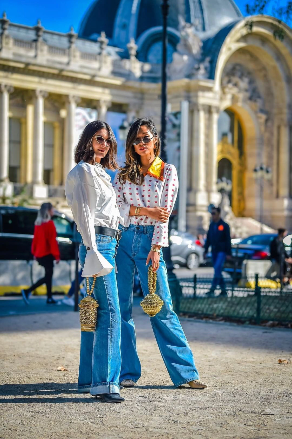 Stylechine's resident columnist's Felicia Evalina spotted with Anisa Soijka wearing the Mae Cassidy, Simi Sparkle and Rekha Reflect Bracelet clutch bag at Paris Fashion Week.  Anisa and Felicia styled the bags with a casual 70's twist; casualing down their look with Circuit Collective flared jeans and oversized, wide collar, Lisou and EDIT Collection shirts - to achieve a twinning look we're envious of! Grab your gal pal and get shopping this autumn look! photo by david yanzi