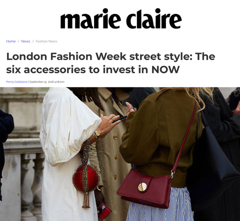 Anisa Sojka spotted at London Fashion Week wearing the fiery Red Babi Bracelet Clutch Bag. Photographed by David Nyanzi. Mae Cassidy Gold clutch bag street style LFW clutch bag red gold handbag occasionwear streetstyle with a white balloon sleeve EDIT dress and white Yuul Yie leather sling back the six accessories to invest in now