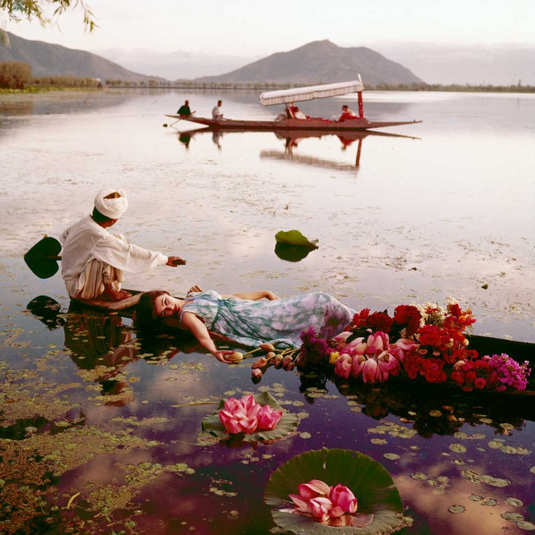 Norman Parkinson India British Vogue 1957   Floating with flowers, India, Vogue. Barbara Mullen floating in a cotton mousseline dress by Atrima. 1956
