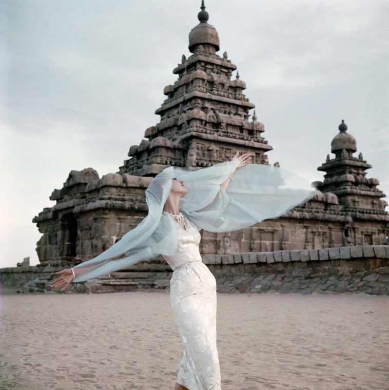 Norman Parkinson India British Vogue 1957 Shore temple at Mahabalipuram, India Barbara Mullen moonstone-blue organza coat by Horrockses at Chanelle, Knighstbridge. 1956
