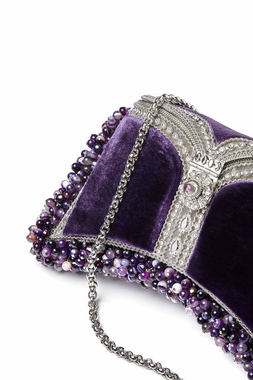 SHOP Mae Cassidy - Only 1 of 100 pieces made as part of our AW20, Limited Edition 'In The Stars' Collection. The Zeenat Gemstone Clutch Bag; handmade from silver-tone metalwork, scores of shimmering crystals and over 1200 semi-precious, Balancing Chevron Amethyst gemstones, each individually threaded onto intricate silver-tone metal pins. Contrasted by deep violet purple, plush velvet panels.