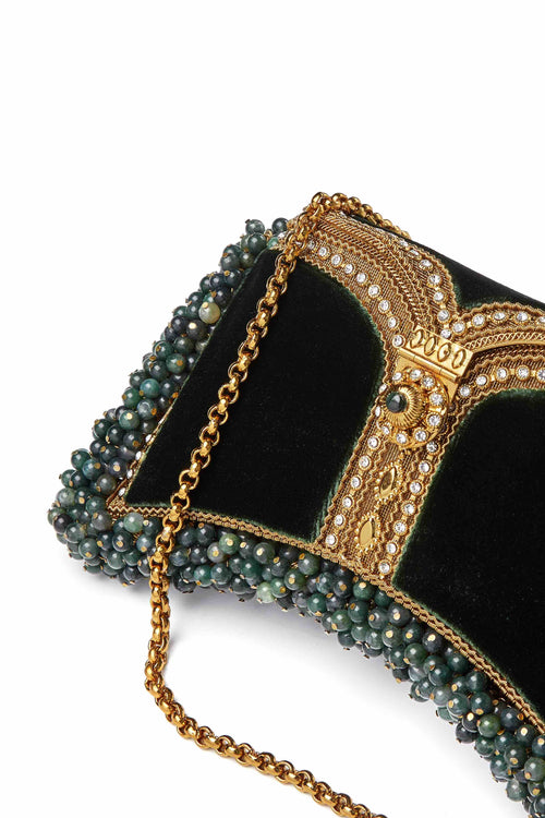 SHOP Mae Cassidy - Only 1 of 100 pieces made as part of our AW20, Limited Edition 'In The Stars' Collection. The Zeenat Gemstone Clutch Bag; handmade from gold -tone metalwork, scores of shimmering crystals and over 1200 semi-precious, Calming Indian Green Agate gemstones, each individually threaded onto intricate gold-tone metal pins. Contrasted by deep green plush velvet panels.