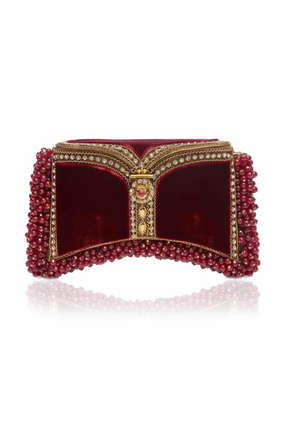 SHOP Mae Cassidy - Only 1 of 100 pieces made as part of our AW20, Limited Edition 'In The Stars' Collection. The Zeenat Gemstone Clutch Bag; handmade from gold-tone metalwork, scores of shimmering crystals and over 1200 semi-precious, Strengthening Red Onyx gemstones, each individually threaded onto intricate gold-tone metal pins. Contrasted by deep red plush velvet panels.