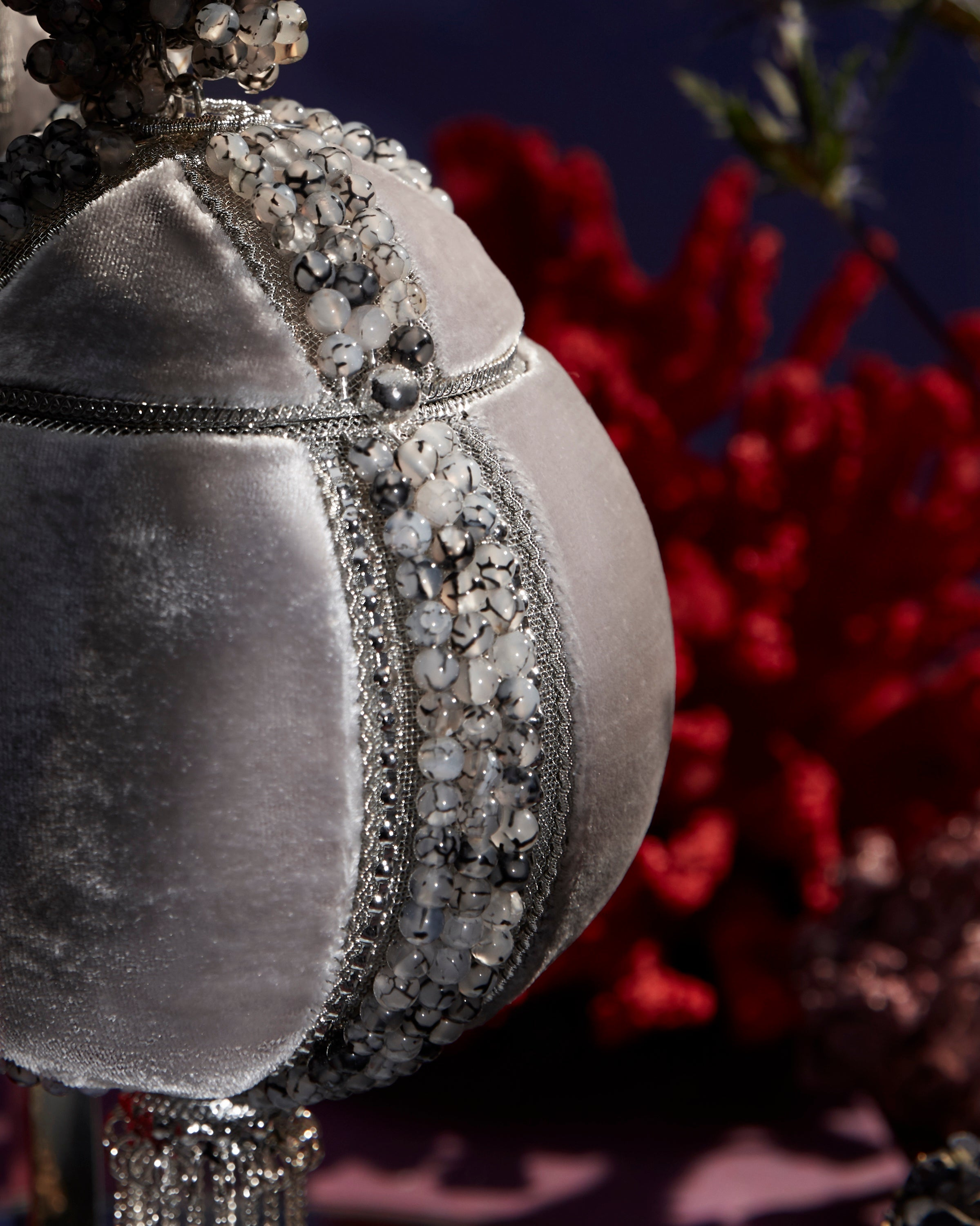 SHOP Mae Cassidy - Only 1 of 100 pieces made as part of our AW20, Limited Edition 'In The Stars' Collection. The Babi Gemstone Bracelet clutch bag, is the ultimate party piece. Handmade from intricate silver-tone metalwork, grey velvet panels and 1200 semi-precious, Grounding Moonstone Grey Agate semi-precious gemstones.