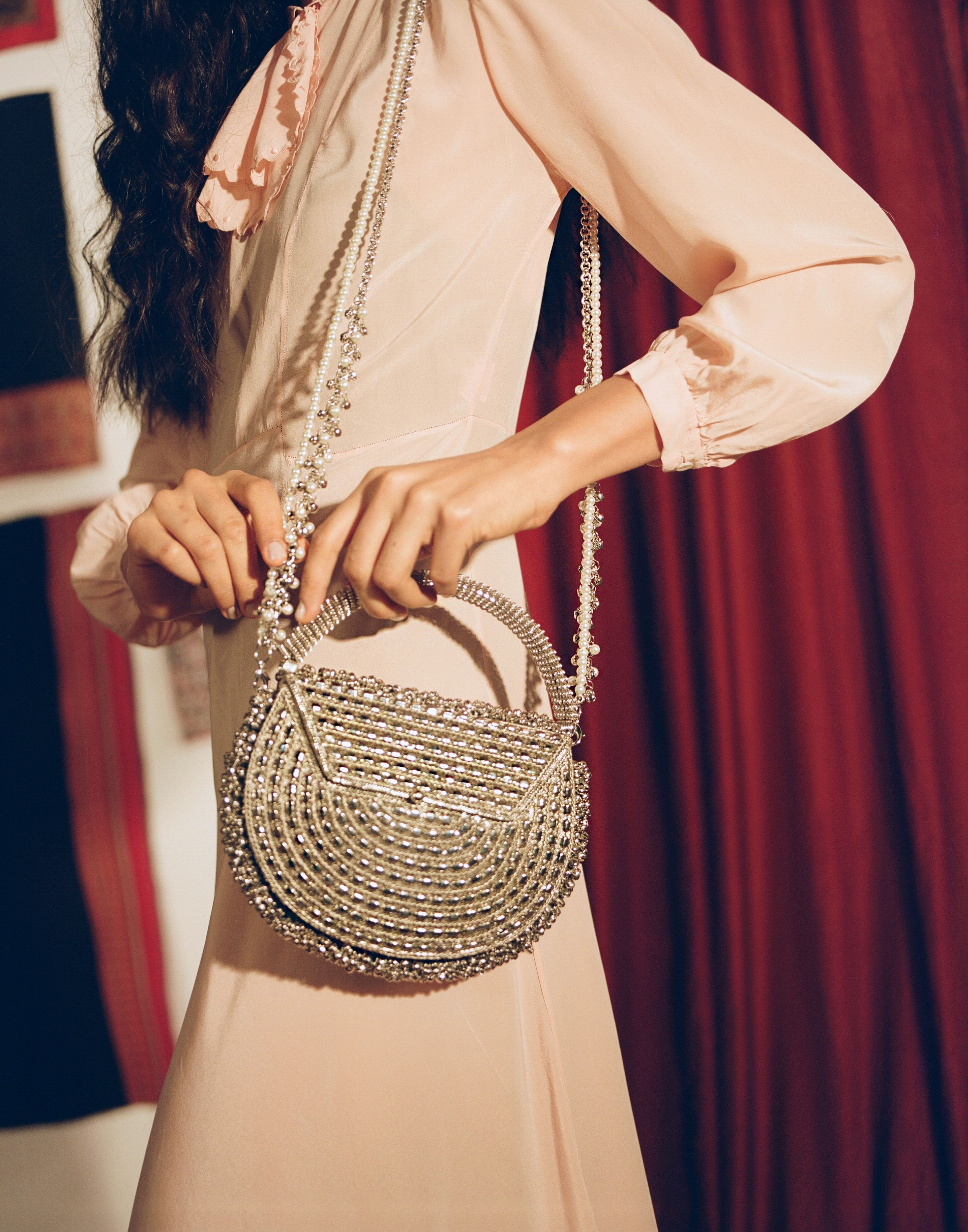 Mae Cassidy Silver Malini Pearl Handbag Bracelet Clutch Bag. Modelled by Emma Laird. Photography by Annie Lai. As seen in Evening Standard, Hello Fashion