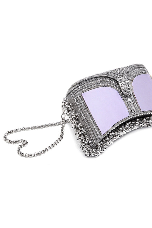 Mae Cassidy Zeenat Moonstone Lilac Silver Clutch Bag. Modelled by Emma Laird. Photography by Annie Lai.