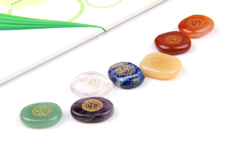 Image of 7 Piece Chakra Carved Crystal Meditation Palm Stones Set
