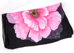 A simple flower makes a bold statement on this airy chiffon scarf. pink black