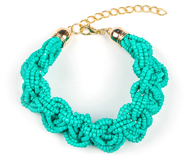 Rich hues and a bold braided bead design give this bohemian bracelet a statement piece appeal. Dress it up or down. Turquoise