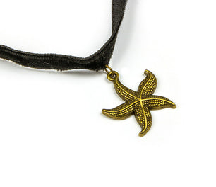 A fabric band with vintage gold closure, and starfish pendant. Chic and unique. Adjustable ~13""