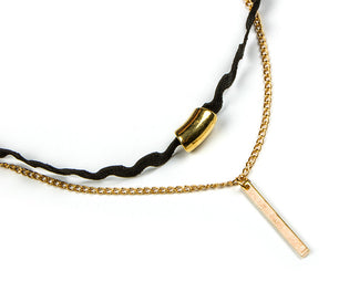 "Two layers, one of black velvet, the other a slim gold link chain with a subtle gold bar pendant. So cute, so chic. ~13"" adjustable."