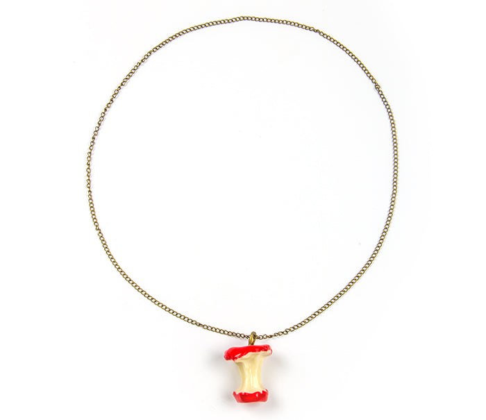 "A fun and quirky eaten apple pendant along a slim chain. Add for fun. ~24"" red"