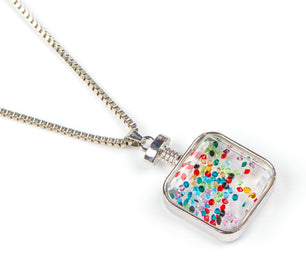 Tiny floating multi colored crystals add movement to this beautiful and unique necklace.