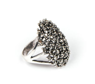Vintage silver and a burst of crystals make this ring a bold and beautiful choice.