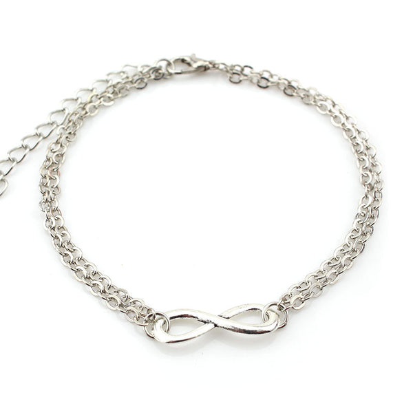 Double chain gold cast, anklet with a simple infinity loop charm. Adjustable and in silver and gold. gold