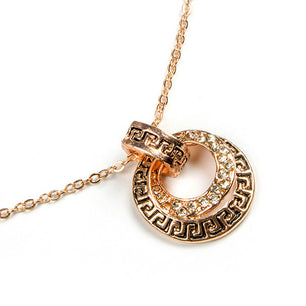Round gold pendants engraved with a simple design make for a lovely and chic necklace and earring set.