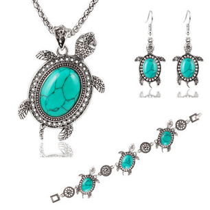 Cute turquoise turtles and silver make this necklace and drop earring set feel fun and flirtatious.