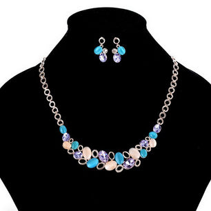 This sweet and simple design necklace and earring set add a romantic feel. Crystal and beads arranged in a flower-like pattern, so cute.
