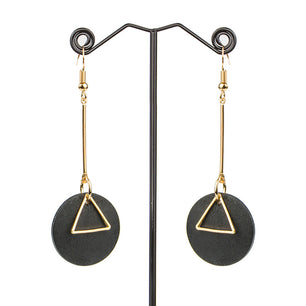 Small wood rounds adorned with gold triangles. black