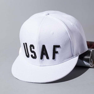 Black USAF cap with lettering in white.
