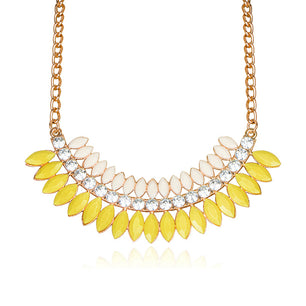 The bold and beautiful bead shape of this necklace make it a great addition. In sunny yellow.