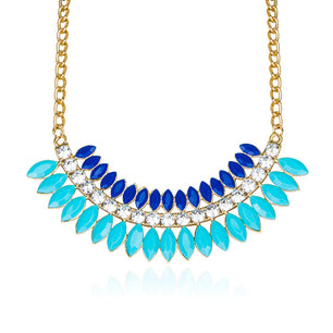 The bold and beautiful bead shape of this necklace make it a great addition. In bright blue.