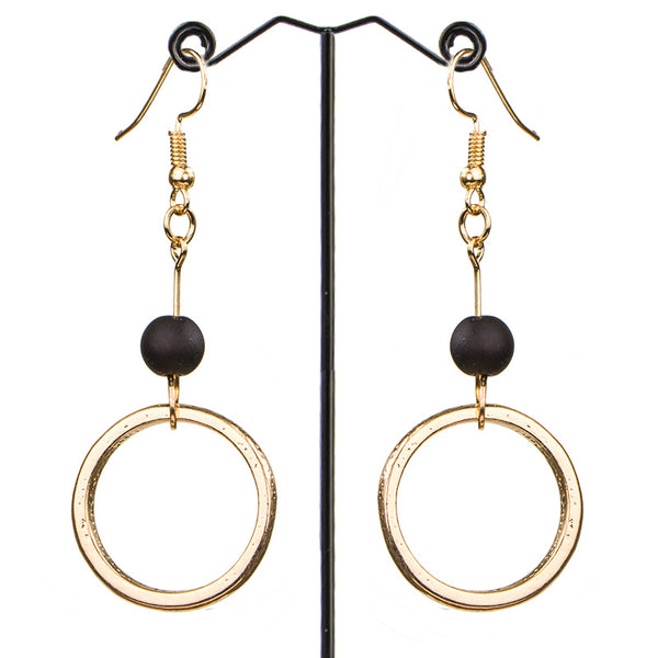 A gold circle sits beneath a small wooden bead in these lovely drop earrings. black