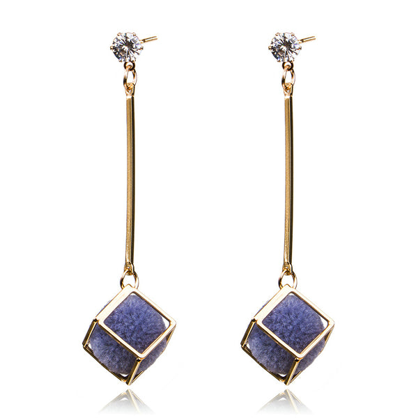 A sphere encases in a gold cube adorned with a crystal. Such stylish and chic earrings. black