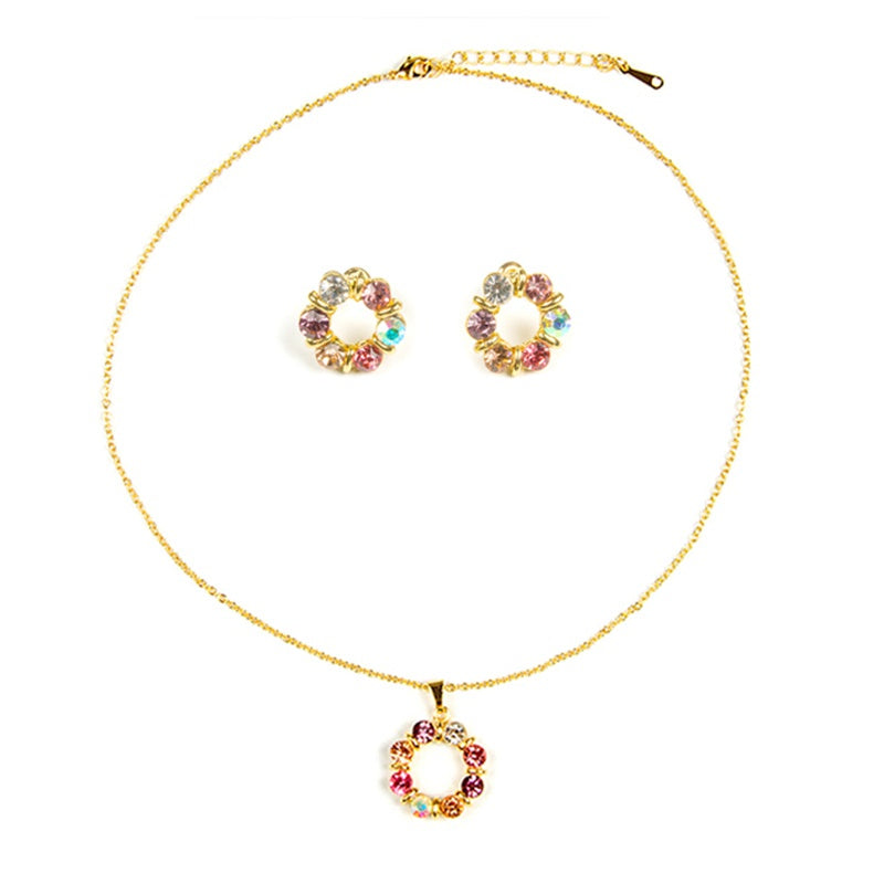 Small colorful crystals encased in gold make for a fun, sweet and flirty necklace and earring set.
