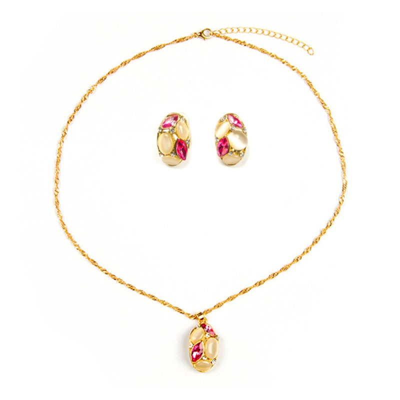 Opal gems encased in gold give this necklace and earring set a simple and beautiful look.