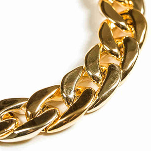Thick gold, silver and vintage silver plated links give this necklace a bold yet simple look. gold