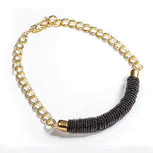 A row of richly colorful beads along a single gold link chain add elegance and style to this necklace. black