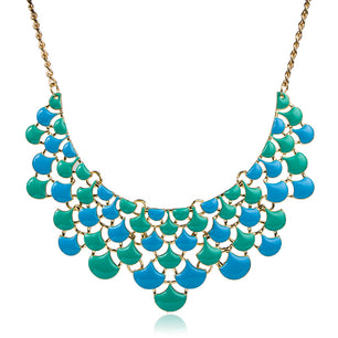 Little colorful drops come together in a beautiful patterned statement necklace. In black, yellow and blue.