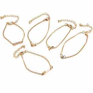 Five chainlink bracelets with simple and cute designs like moons, crystals, stars and more.