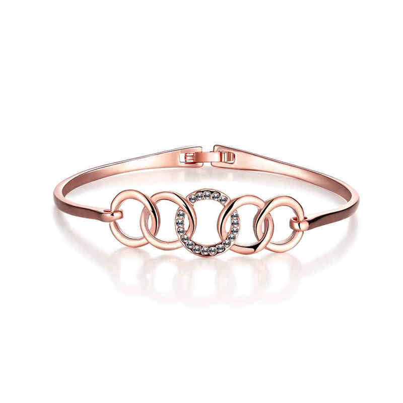 The five circles, one of which is covered in crystals, makes this a gorgeous bangle.