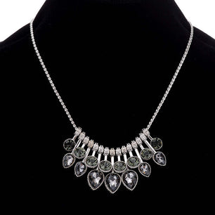 This beautiful piece features a water drop crystal design along a silver chain. Elegant and unique.