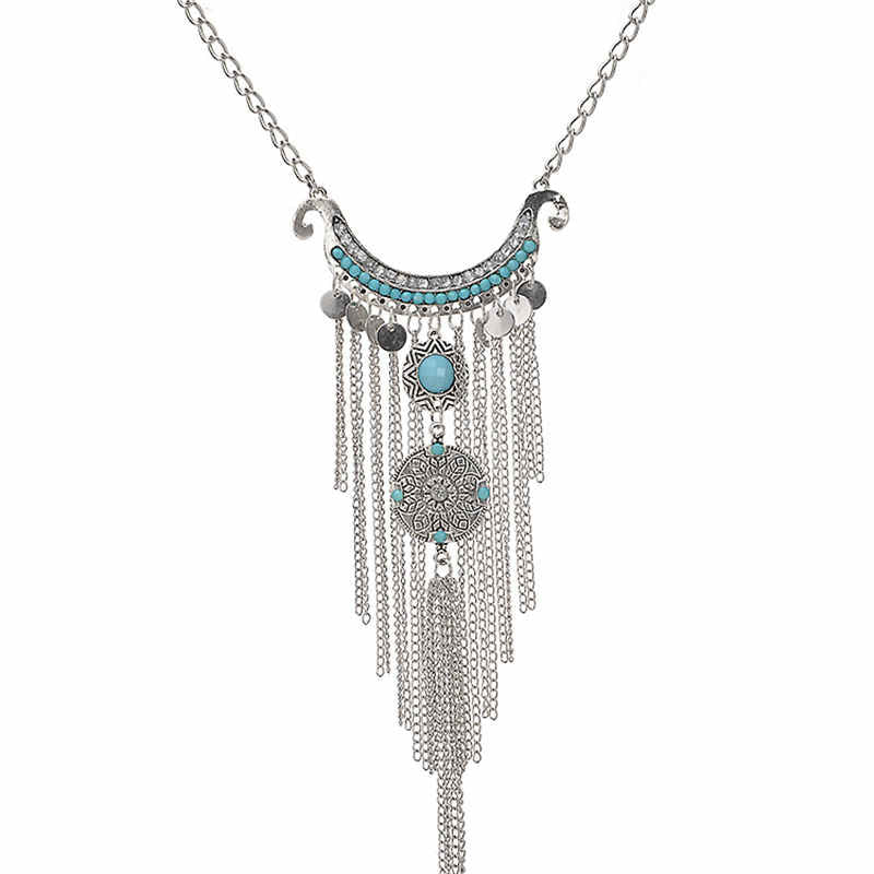 A silver tassel necklace adorned with turquoise, bold and beautiful.