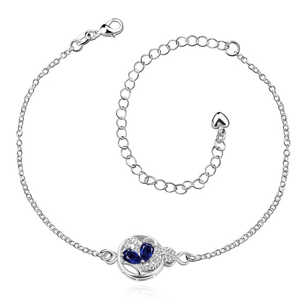 Little water drop gems encased in a silver chainlink anklet. Cute and simple.