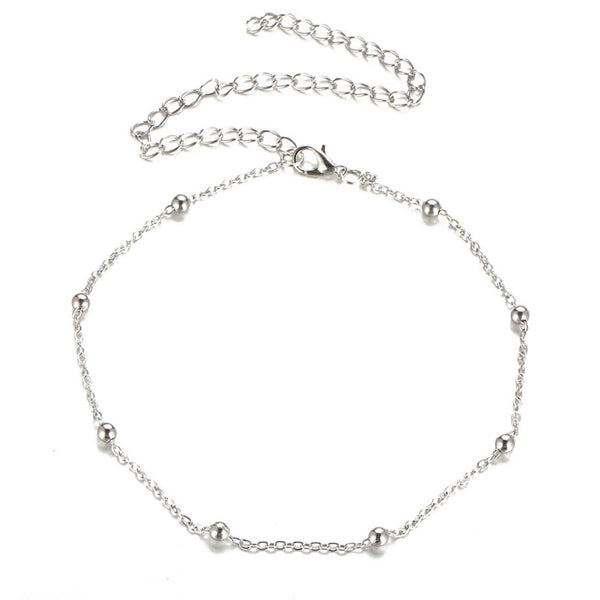 "Little gold or silver beads on a subtle chain link make this choker a cute and classic addition. Adjustable ~12"" gold"