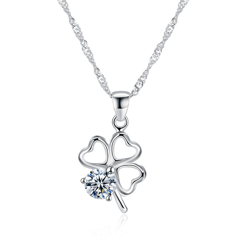 Sterling silver necklace in a shape of a four leaf clover, adorned with zircon stone.