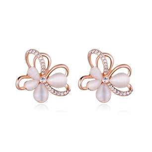 Opal stone, crystal and rose gold meet in these beautifully unique flower shaped studs. A must.