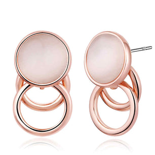 An opal stone encased in two rose gold loops give these studs a classic and chic look.
