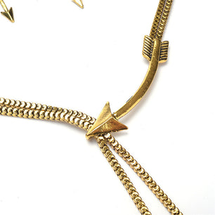 Gold arrows along a sleek chain give this piece a unique feel, with earrings to match.