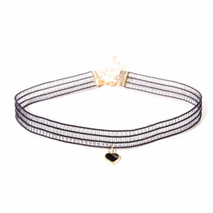 This cute and unique lace choker features fine lace, a subtle heart shaped gem and gold detail closure.