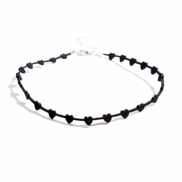 "Vegan leather cut into small hearts makes this adorable choker a must. Adjustable ~13"" black"