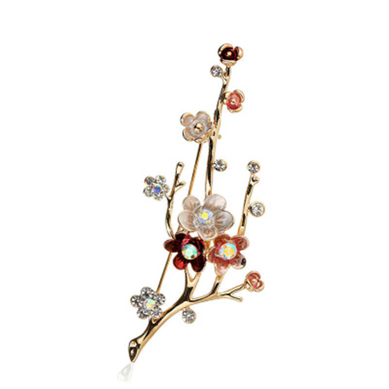 This brooch captures plum blossoms in bloom. Elegant and unique, gold detail.