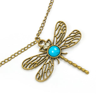 A vintage gold dragonfly pendant with turquoise detail along a subtle gold chain. ~24""
