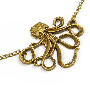 "This octopus shaped pendant is along a vintage gold chain. Add uniqueness. ~24""This octopus shaped pendant is along a vintage gold chain. Add uniqueness. ~24"""