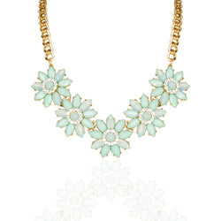 The bold and the beautiful. This statement necklace designed with gem flowers and crystals is cute and elegant. Gold link chain.